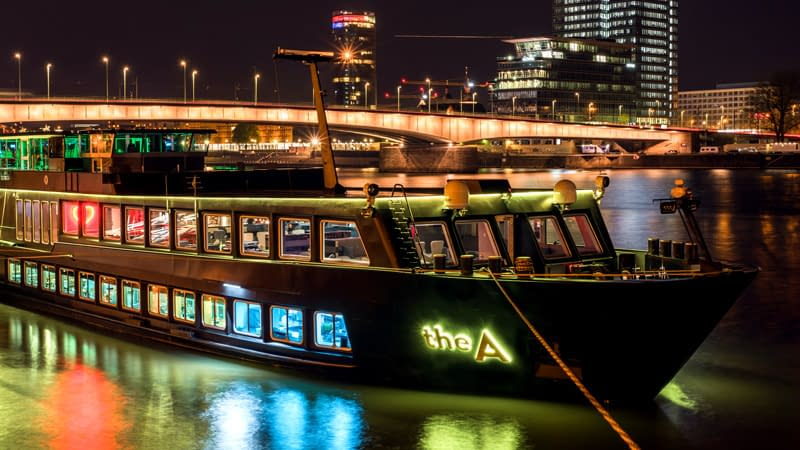 Nightime photo of river cruise boat